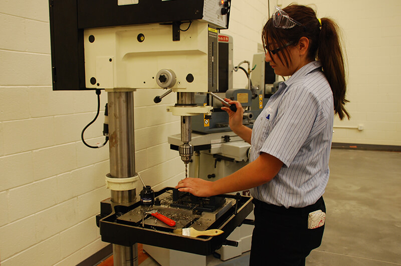 photo: student working with machining tool