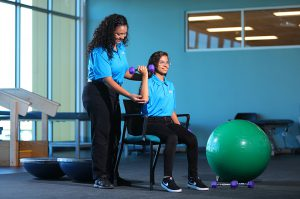 Photo:West-MEC Career Training Program student providing physical therapy