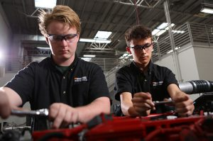 photo: students working on engine