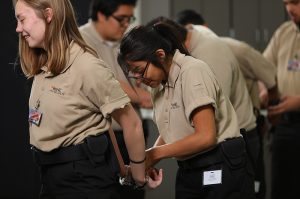 photo: West-MEC Career Training Program Law & Public Safety students putting on handcuffs