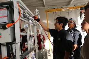 photo: energy students working on equipment