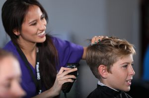 photo: student giving a haircut