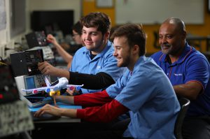 Photo: avionics students with instructor