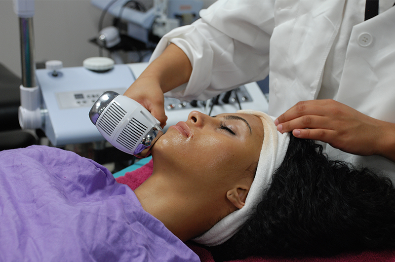 Photo: aesthetician student providing treatment