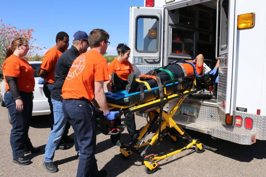 EMT students with patient